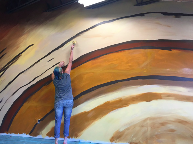 Tyler artist shares vision behind tree-inspired gym mural